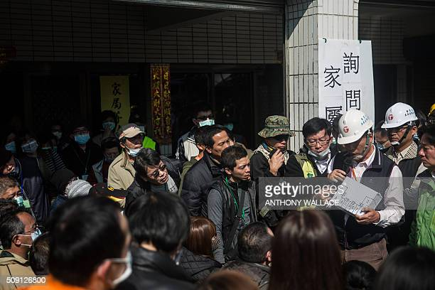 Cheng Mingchang president of Tainan Civil Engineers Association uses a diagram as he and Tainan's Mayor William Lai brief relatives on the rescue...
