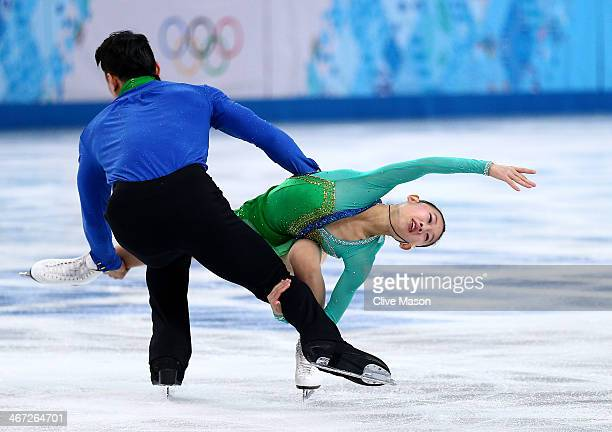 Cheng Peng and Hao Zhang of China compete in the Figure Skating Pairs Short Program during the Sochi 2014 Winter Olympics at Iceberg Skating Palace...
