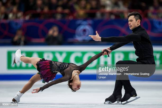 Cheng Peng and Yang Jin of China compete in the Pairs Free Skating during day two of the World Figure Skating Championships at Mediolanum Forum on...