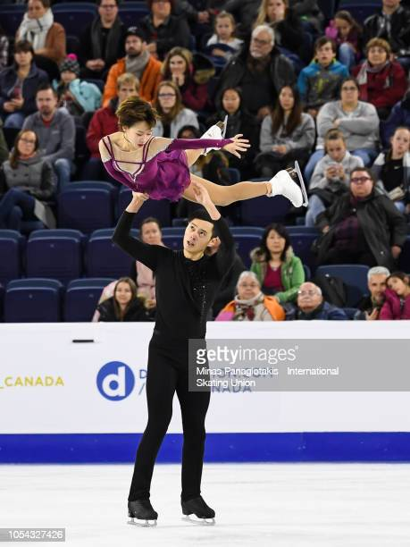 Cheng Peng and Yang Jin of China compete on day two during the ISU Grand Prix of Figure Skating Skate Canada International at Place Bell on October...
