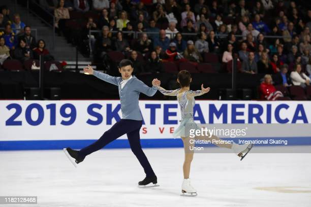 Cheng Peng and Yang Jin of China perform during pairs free skating in the ISU Grand Prix of Figure Skating Skate America at the Orleans Arena on...