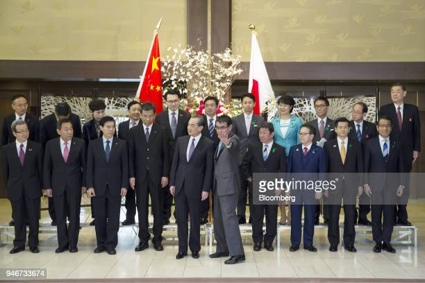 Cheng Yonghua China's ambassador to Japan front row from left to right Zhang Yong vice director of China's National Development and Reform Commission...