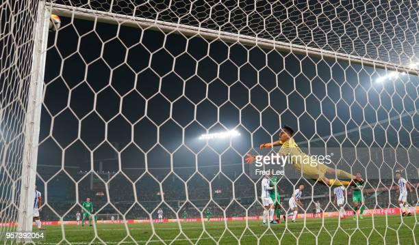 Cheng Yuelei of Guangzhou RF saves a ball during 2018 China Super League match between Beijing Guoan and Guangzhou RF at Beijing Workers Stadium on...