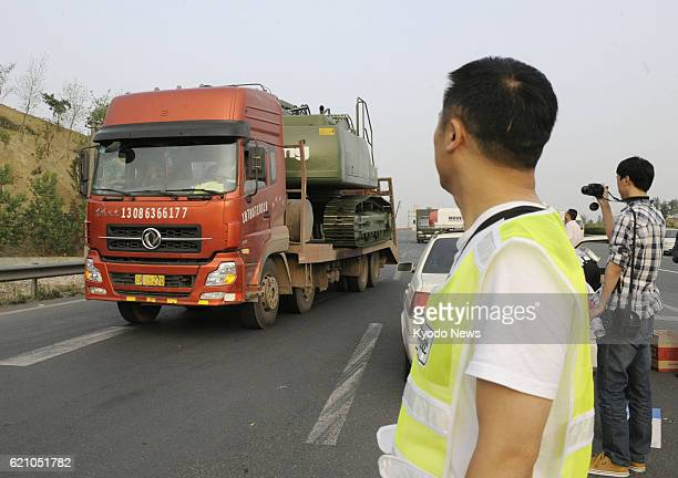 Chengdu China Photo taken in Chengdu Sichuan Province China on April 20 shows a vehicle loaded with heavy machinery heading to a disaster site after...