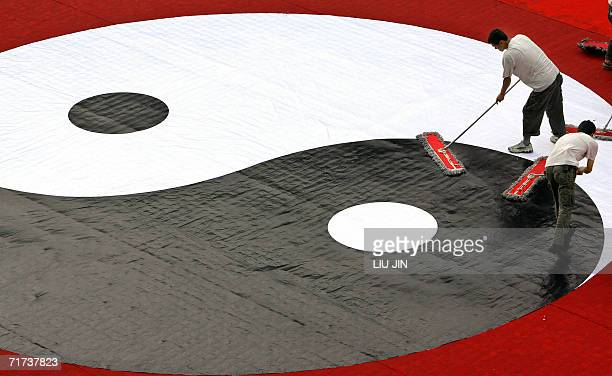 Workers clean a ying and yang symbol upon the closing ceremony of the second China Taoism Culture festival in Chengdu China's southwestern province...