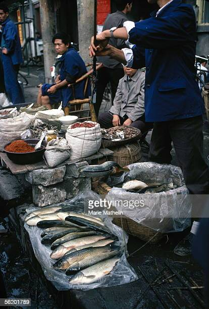 Chengdu Stalls of fishes and spices in the market of the old city 1983