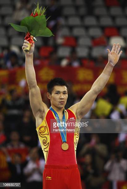 Chenglong Zhang of China celebrates after winning gold in the Men's Horizontal bar final during the artistic gymnastics on day five of the 16th Asian...