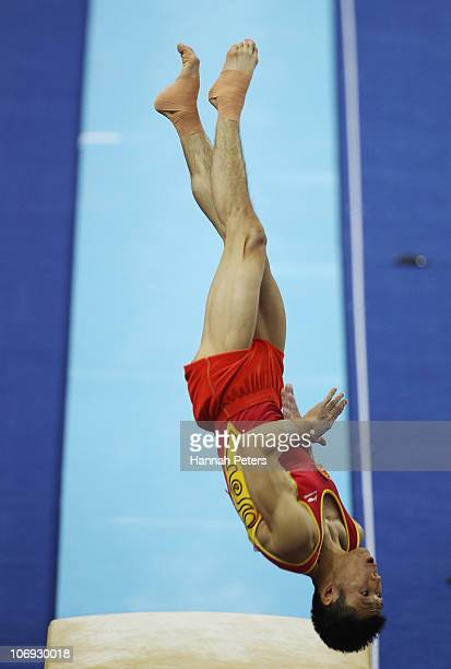 Chenglong Zhang of China competes in the Men's Vault final during the artistic gymnastics on day five of the 16th Asian Games Guangzhou 2010 at Asian...