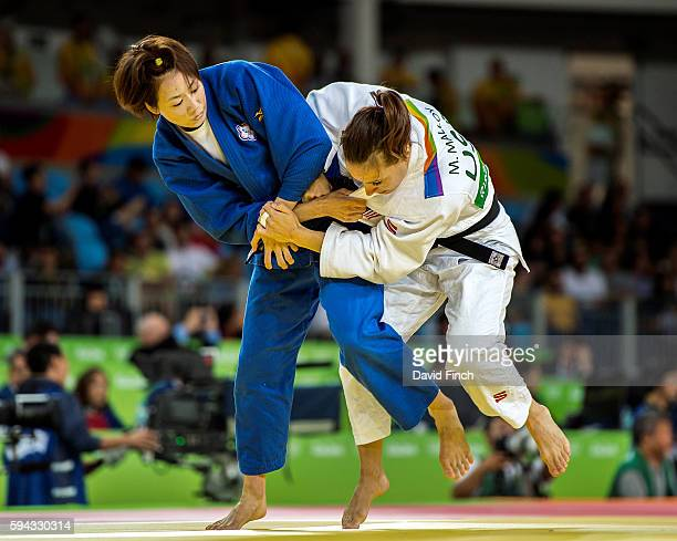 ChenLing Lien of Taipei attacks Olympic and world medallist Marti Malloy of the United States eventually winning the u57kg contest by 2 shido during...