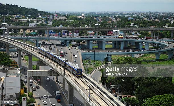 A Chennai Metro Rail train travels along the track between the airport and Little Mount in Chennai on September 212016 Chief Minister of Tamil Nadu J...