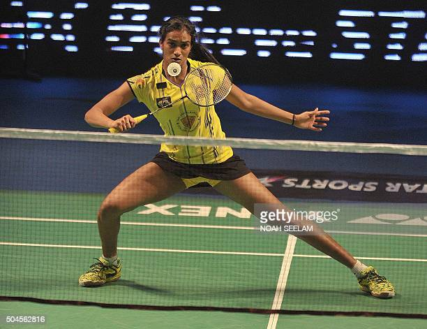 Chennai Smashers player PVSindhu returns to Vrushali of Awadhe Warriors during their Premier Badminton League match in Hyderabad on January 11 2016...