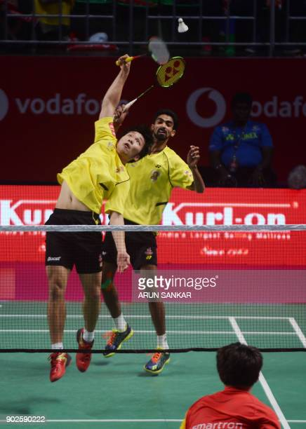 Chennai Smashers players Lee Yang and Sumeeth Reddy return the shot to Bengaluru Blasters players Mathias Boe Kim Sa Rang during their men's...