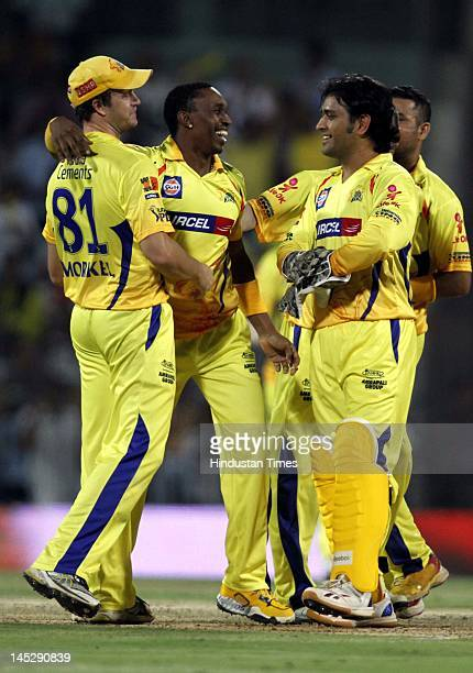 Chennai Super Kings captain MS Dhoni celebrates with teammates after winning the IPL Qualifier 2 match against Delhi Daredevils at MA Chidambaram...