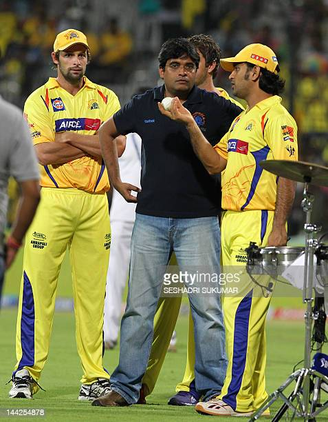 Chennai Super Kings captain MS Dhoni chats with CSK Owner Gurunath Meiyappan and Ben Hilfenhaus as they attend the presentation ceremony during the...