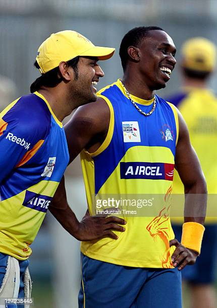 Chennai Super Kings captain MS Dhoni share a light moments with Dwayne Bravo during a practise session at M A Chidambaram Stadium in Chennai India on...