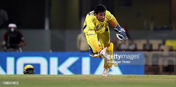 Chennai Super Kings captain MS Dhoni throwing the ball during the Champions League Twenty20 Group A match between Chennai Super Kings and Trinidad...