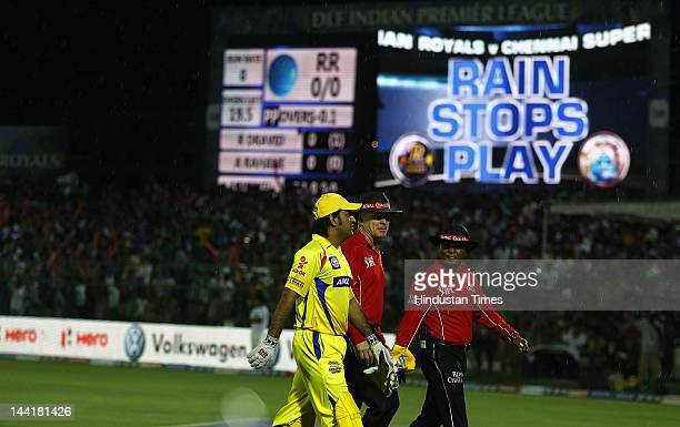 Chennai Super Kings captain M S Dhoni walks with umpires as rain delayed play at Sawai Man Singh Stadium on May 10 2012 in Jaipur India Chasing the...