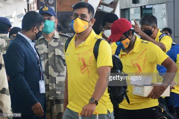 Chennai Super Kings captain Mahendra Singh Dhoni arrives along with his teammates at the airport to take a flight to Dubai for the upcoming Indian...