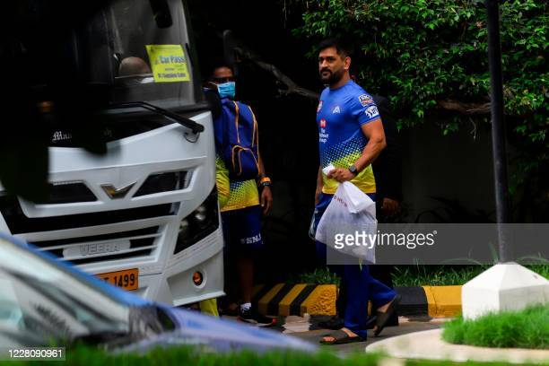 Chennai Super Kings captain Mahendra Singh Dhoni boards a bus before a team practice at the MA Chidambaram cricket stadium in Chennai on August 18,...