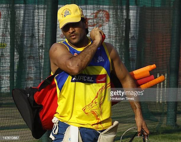 Chennai Super Kings captain Mahendra Singh Dhoni during the practice session at the Ferozshah Kotla Stadium on April 9 2012 in New Delhi India...