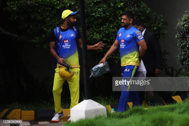 Chennai Super Kings captain Mahendra Singh Dhoni walks to board a bus before a team practice at the MA Chidambaram cricket stadium in Chennai on...