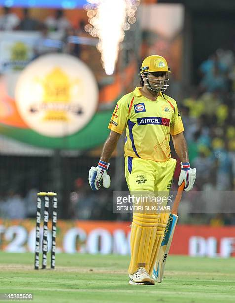 Chennai Super Kings captain MD Dhoni returns to the pavilion aftre being caught by Negi and bold by Aaron for 23 during the IPL Twenty20 cricket 2nd...