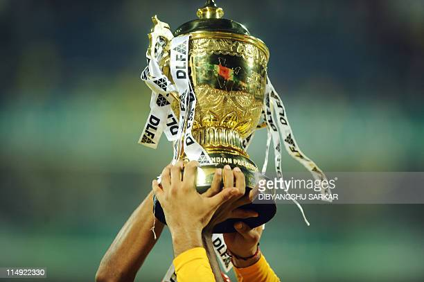 Chennai Super Kings players celebrate with the trophy after the IPL Twenty20 cricket final match between Chennai Super Kings and Royal Challengers...