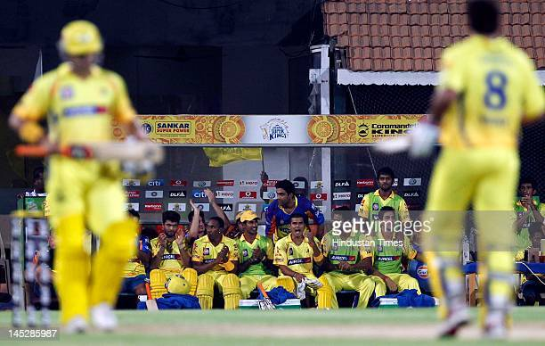 Chennai Super Kings players in dugout cheer up Murali Vijay and MS Dhoni batting during the IPL Qualifier 2 match between Delhi Daredevils and...