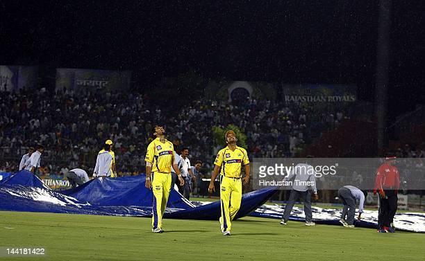 Chennai Super Kings players Murli Vijay and Suresh Raina leaves the ground as rain stops play during IPL 5 T20 match played between Rajasthan Royals...