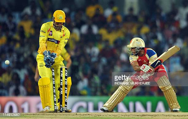 Chennai Super Kings wicketkeeper Mahendra Singh Dhoni looks on as Royal Challengers Bangalore batsman Mayank Agarwal is bowled out during the IPL...