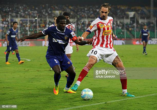 Chennaiyin FC Defender Bernard Mendy vies for the ball with Atletico De Kolkata midfielder Borja Fernandez during the Indian Super League football...