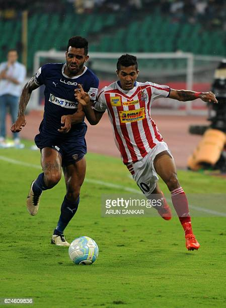 Chennaiyin FC defender Eli Sabia Filho vies for the ball with Atletico De Kolkata midfielder Broja Fernandez during the Indian Super League football...