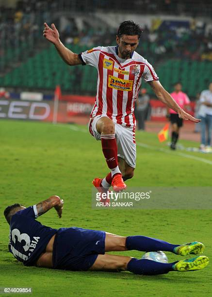 Chennaiyin FC defender Eli Sabia Filho vies for the ball with Atletico De Kolkata forward Helder Manuel Postiga during the Indian Super League...