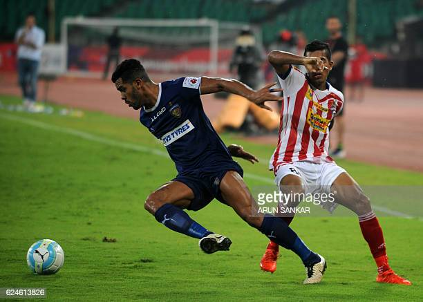 Chennaiyin FC defender Eli Sabia Filho vies for the ball with Atletico De Kolkata defender Keegan Pereiera during the Indian Super League football...