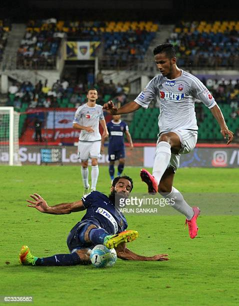 Chennaiyin FC defender Mehrajuddin Wadoo vies for the ball with FC Pune City's defender Narayan Das during the Indian Super League football match...