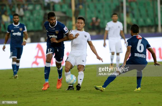 Chennaiyin FC Dhanapal Ganesh vies for the ball with NorthEast United FC Ralte during the Indian Super League football league match between...