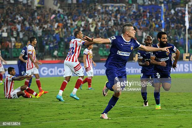 Chennaiyin FC Forward Davide Succi celebrates after scoring a goal against Atletico De Kolkata during the Indian Super League football match between...