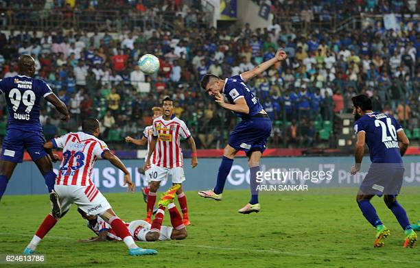 Chennaiyin FC forward Davide Succi heads the ball towards the goal during the Indian Super League football match between Chennaiyin FC and Atletico...