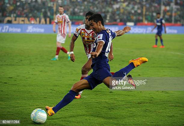 Chennaiyin FC forward Jayesh Rane kicks the ball during the Indian Super League football match between Chennaiyin FC and Atletico De Kolkata at The...