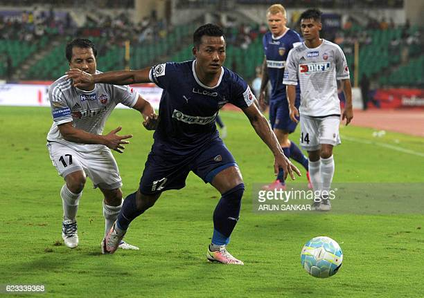 Chennaiyin FC' forward Jeje Lalpekhlua vies for the ball with FC Pune City's defender Yamnam Raju during the Indian Super League football match...