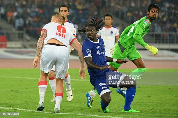 Chennaiyin FC French defender Bernard Mendy plays aganist Sanjiban Ghosh during the Indian Super League football match between Delhi Dynamos FC and...