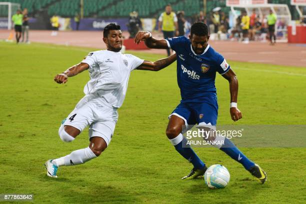 Chennaiyin FC Gergory Nelson vies for the ball with NorthEast United FC Nirmal Chettri during the Indian Super League football league match between...
