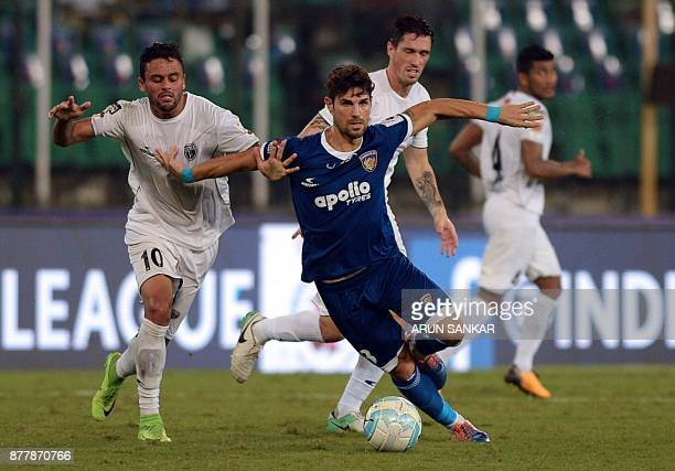 Chennaiyin FC Jaime Gavilan Martinez vies for the ball with NorthEast United FC Marcio De Souza Greogorio during the Indian Super League football...