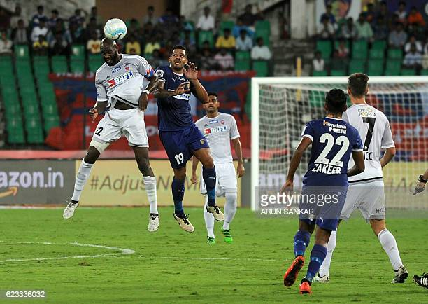 Chennaiyin FC midfielder Raphael Augusto vies for the ball with FC Pune City's Mohammed Lamine Sissoko during the Indian Super League football match...