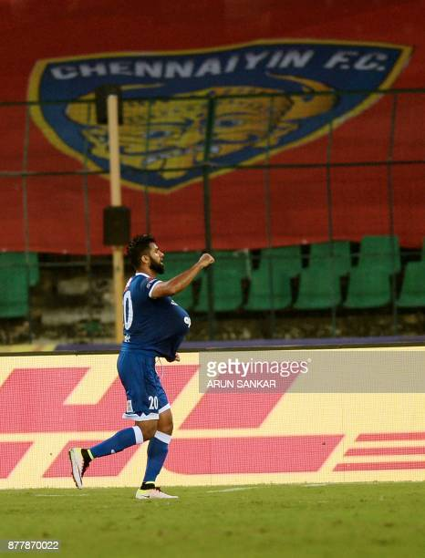 Chennaiyin FC Mohammed Rafi celebrates after scoring a goal against NorthEast United FC's during the Indian Super League football league match...