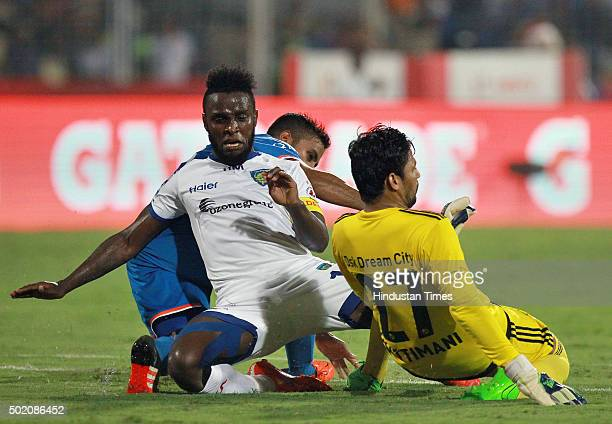 Chennaiyin FC player Stiven Mendoza vying for balls with FC Goa goalkeeper Laxmikant Kattimani during ISL Final match at Jawaharlal Nehru Stadium on...