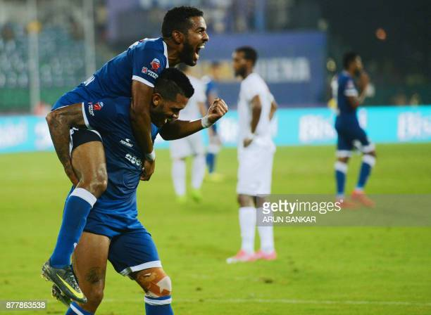 Chennaiyin FC Raphels Augusto celebrates with teammate Gergory Nelson after scoring a goal against NorthEast United FC's during the Indian Super...