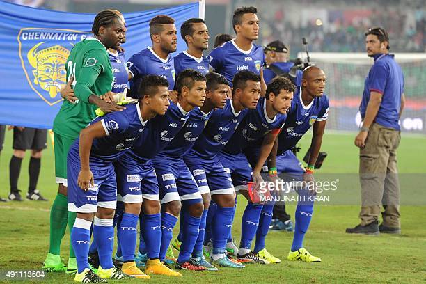 Chennaiyin FC team members pose for a photograph before the start of the Indian Super League football match against AtleticodeKolkata in Chennai on...