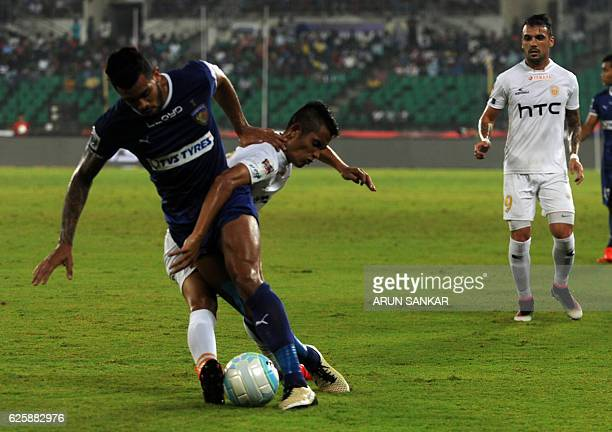 Chennaiyin FC's defender Eli Sabia Filho vies for the ball against NorthEast United FC's MIdfielder Lalrenpuia Fanai during the Indian Super League...