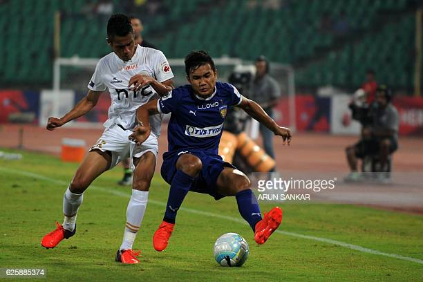 Chennaiyin FC's defender Jerry Lalrinzuala vies for the ball against NorthEast United FC's MIdfielder Lalrenpuia Fanai during the Indian Super League...